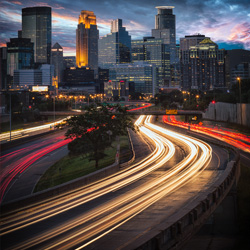 Skyline at twilight of Minneapolis, Minnesota. Long exposure of 20-30 seconds were used to capture the motion of the car lights.